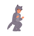 funny little boy wearing wolf costume at childish vector image