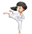 A young woman doing karate vector image vector image