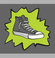 gray sneaker shoe with a splash vector image