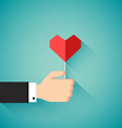 Valentines day concept with hand holding heart vector image