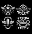 set monochrome tattoo emblems on dark vector image vector image