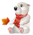 toy white bear with red plaid scarf holding