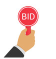 hand with paddle bid vector image vector image