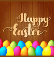 lettering happy easter on wooden background vector image vector image