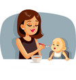 happy mother feeding her basolid food with a vector image vector image