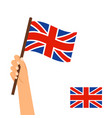 hand holding flag of britain vector image vector image