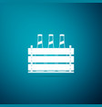 pack of beer bottles icon on blue background vector image vector image