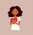 african woman holding a big heart symbol vector image