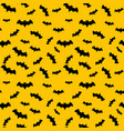 seamless pattern yellow background with bat vector image