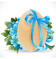yellow egg tied with a blue ribbon with a bouquet vector image vector image