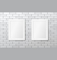 two white picture frames on a white brick wall vector image