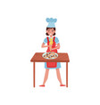 woman decorating donuts with pastry bag vector image