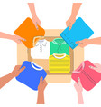 people put clothes into donation box vector image vector image