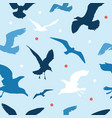 seamless pattern with seagulls on blue background vector image vector image