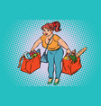 young woman with grocery shopping vector image