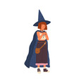 cute girl wearing witch hat and cloak smiling vector image vector image