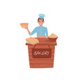 young guy selling fresh bread wooden stall with vector image vector image