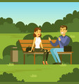 young man and woman sitting on the bench in the vector image vector image