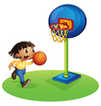 A small boy playing basketball vector image