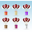 gift package soaring with helium balloons icons vector image