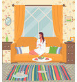 girl at home on yellow couch in a bathrobe