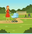 young mother walking with baby carriage in the vector image vector image
