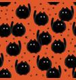 halloween spooky cats seamless pattern on orange vector image