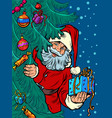 santa claus looks out from behind tree vector image vector image