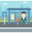 Man waiting for bus at the bus stop vector image vector image
