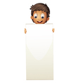 A boy standing with an empty cardboard vector image vector image