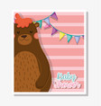 bear with party banner to celebrate baby shower