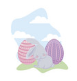 cute rabbit with eggs of easter in grass vector image