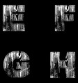 E f g h letters white on a black background wood