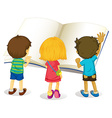 Children reading from big book vector image