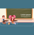 school sall girl and boy sitting at desk over vector image vector image
