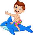cartoon little boy riding a inflatable shark vector image vector image