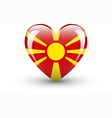 Heart-shaped icon with flag of Macedonia vector image