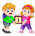 two kids carrying alphabet block vector image