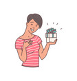 happy woman holding gift box with surprised and vector image vector image