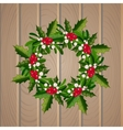 Christmas mistletoe wreath on wooden background vector image vector image