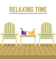 Wooden Chairs And Glasses Of Fruit Juice On Table vector image vector image