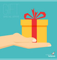 hand with gift box icon vector image