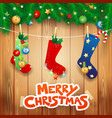 christmas socks and text on wooden background vector image vector image