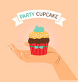 party banner with hand holding cupcake vector image vector image