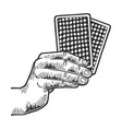 hand with playing cards sketch engraving vector image vector image