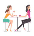 beautiful girls sitting in cafe and talking to vector image vector image