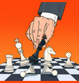 pop art hand of businessman holding chess figure vector image