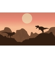Silhouette of T-rex in cliff with sun vector image vector image