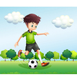 A boy with a green t-shirt playing football vector image vector image