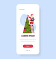 santa claus standing on ladder decorating fir tree vector image